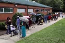 Amid coronavirus, Kentucky, New York report few voting glitches