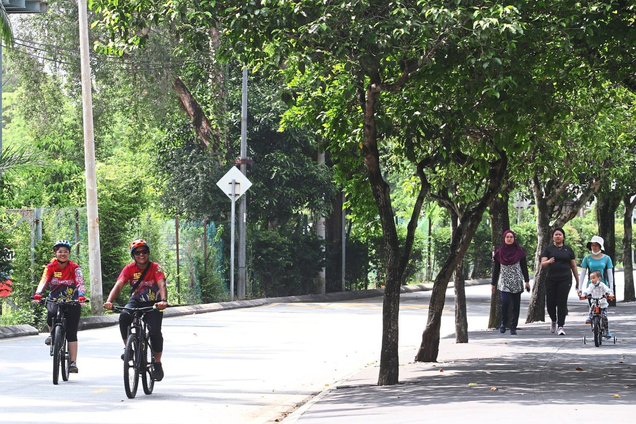 Many people still go to Taman Tasik Titiwangsa to jog and cycle on the track surrounding the park. — Photos: AZLINA ABDULLAH/The Star