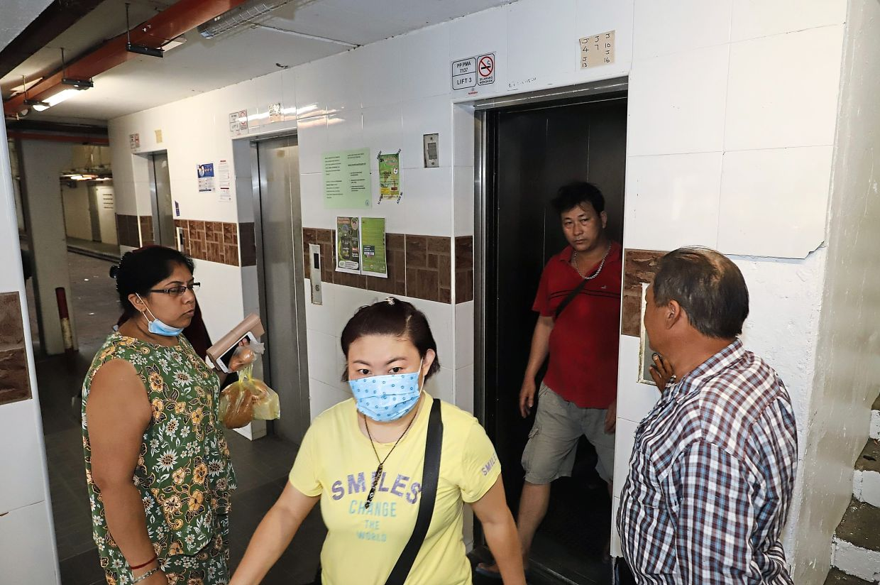 Residents using the lifts at Rifle Range Flats.