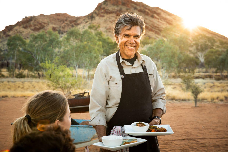 Tuck into bush food prepared by RT Tours' Bob (Pernuka) Taylor. Photo: Tourism NT & Archie Sartracom
