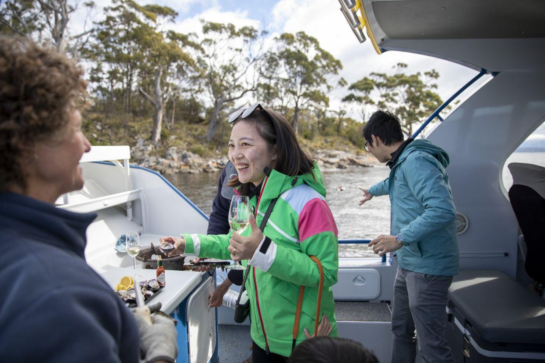 Enjoying fresh seafood on the Seafood Seduction Tour, Tasmania. Photo: Tourism Australia