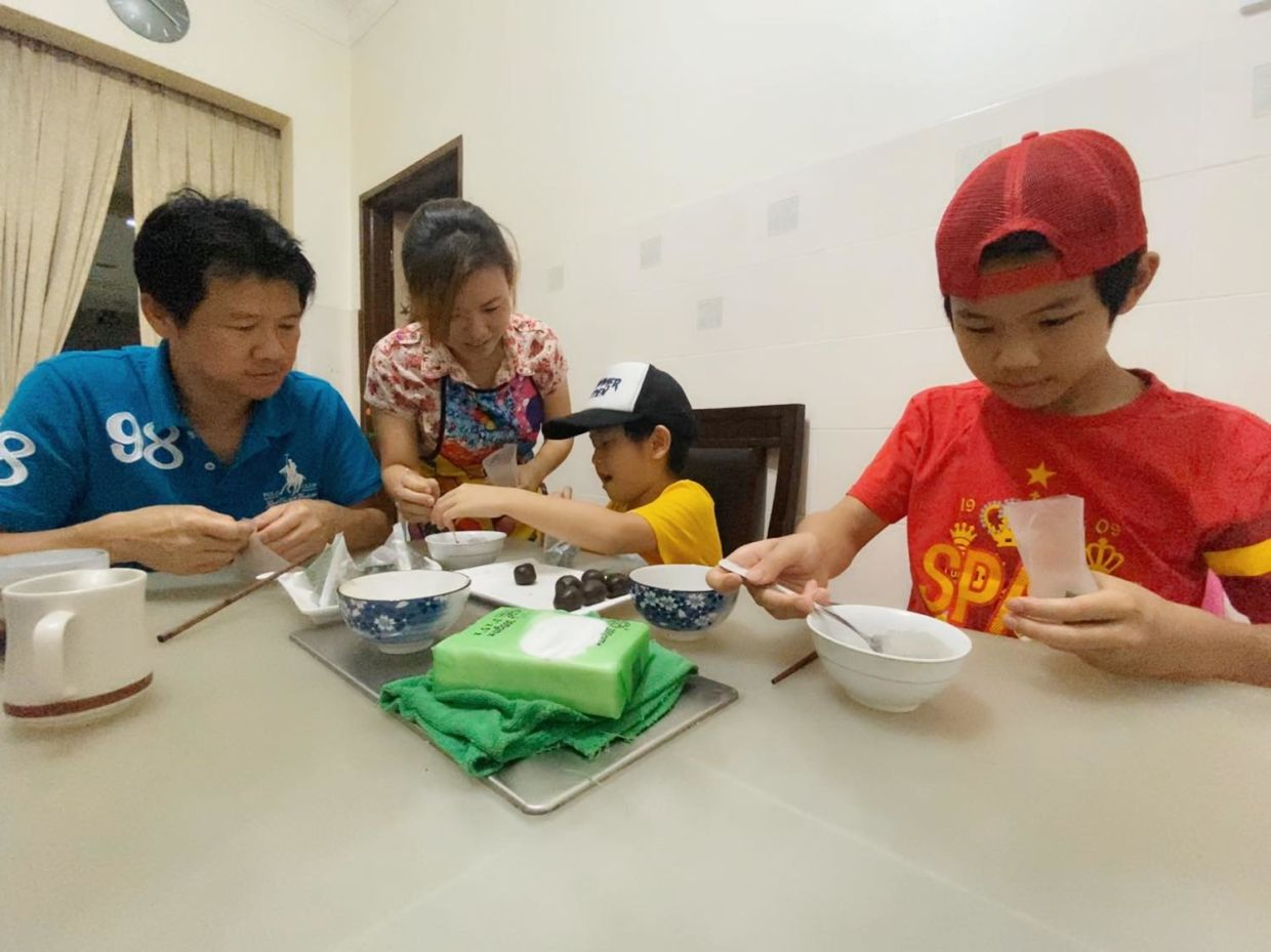 Making dumplings to celebrate the Dragon Boat Festival is a family affair for Tan, her husband Yeow, and their sons Ethan, 13, and Ayden, seven.