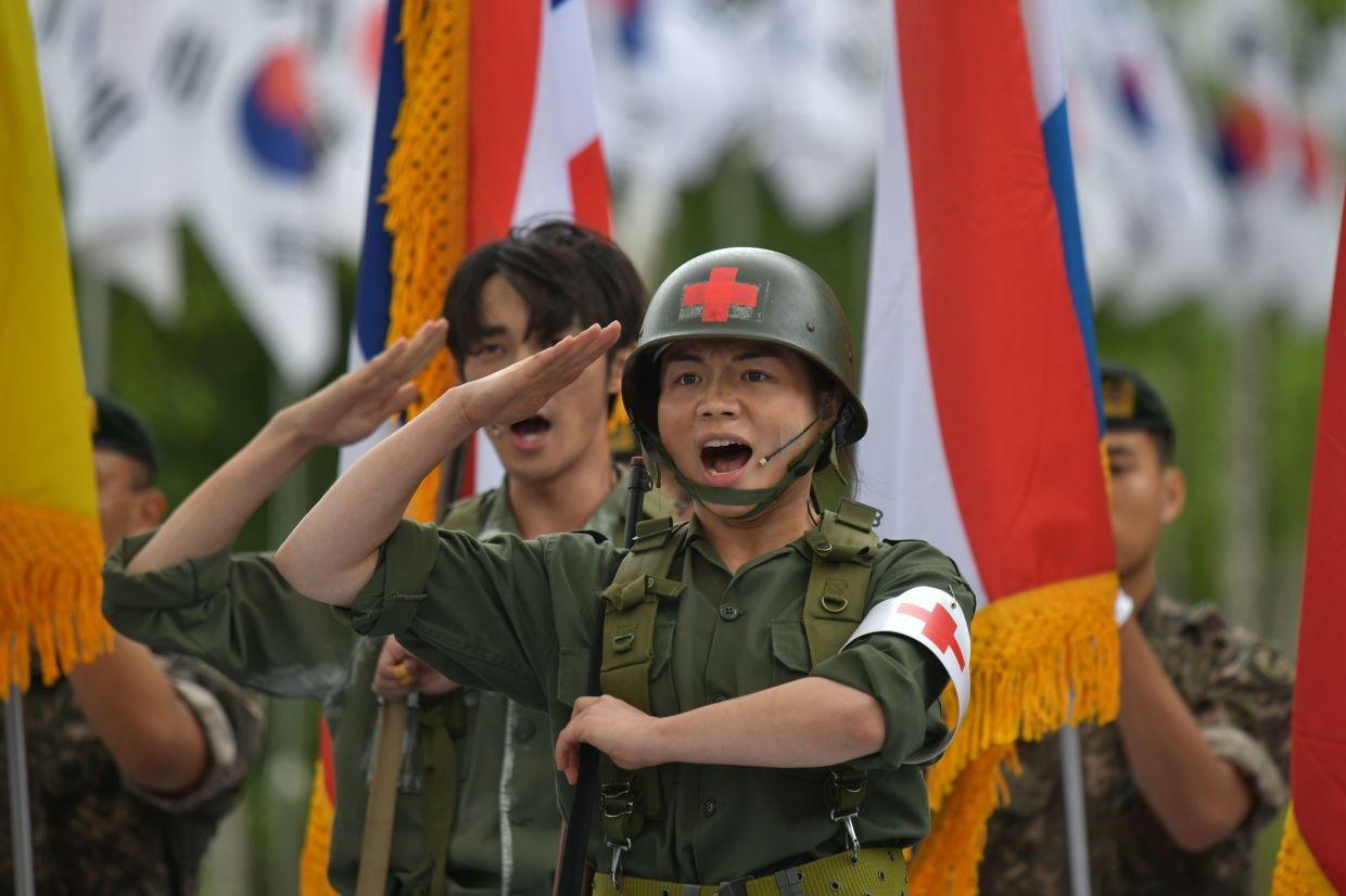 Actors perform at a ceremony marking the 70th anniversary of the start of the Korean War at the Baengmagoji War Memorial in Cheorwon, near the Demilitarized Zone (DMZ) separating North and South Korea. . — AFP
