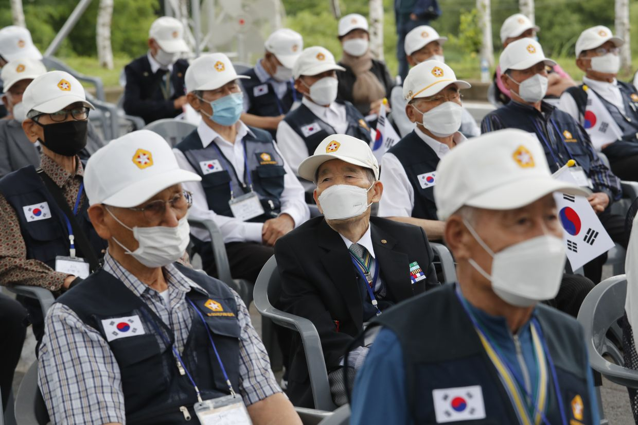 Korean War veterans attend a ceremony to mark the 70th anniversary of the outbreak of the Korean War. Those who went through the atrocities of the war are now old and fade away, making the Korean War 'a forgotten war'. — AP