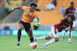 Jimenez-Traore show seals win for Wolves over Bournemouth