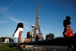 Eiffel Tower reopens after a three-month coronavirus break