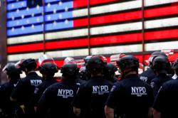 New York City police officer arrested after apparent chokehold arrest
