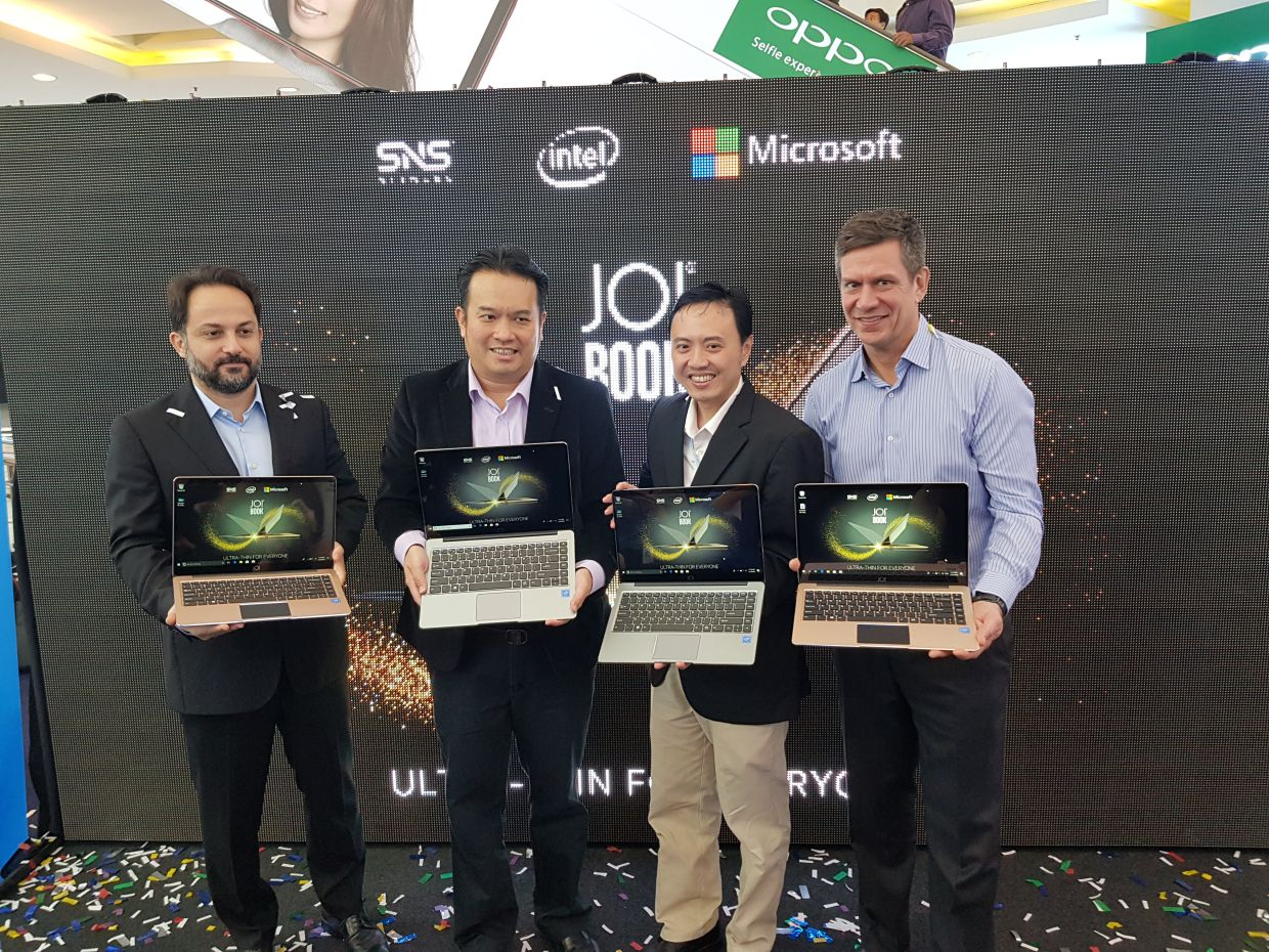 SNS Network's subsidiary JOI launched its own line of notebooks in 2018, which was attended by (from left) Microsoft Asia named lead Cagatay Copuroglu, SNS Network sales and marketing director Kelvin Pah Wai Onn and COO Ko Yun Hung, as well as Intel Asia retail sales director Cekiel Danielson. — SNS Network