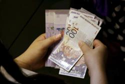 Ringgit eases as demand shifts to safe-haven currencies
