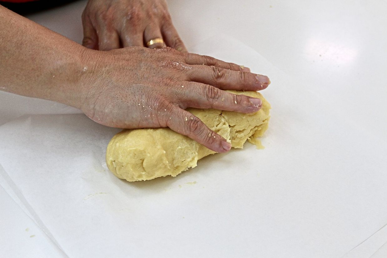 Divide ball of pastry dough into two logs and wrap each log in parchment paper to chill for at least an hour.