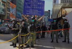 China lawmakers review draft of Hong Kong national security bill; Hong Kongers march in silent protest against law