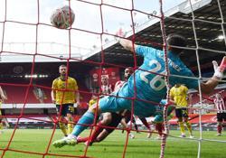 Ceballos stoppage-time strike sends Arsenal into semis