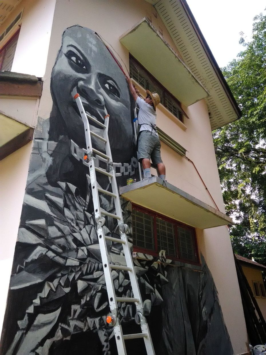 The lockdown delayed Shaq Koyok's mural project, but once the restrictions eased up he was back at work. He finished the mural last weekend. Photo: Brandon Ritom