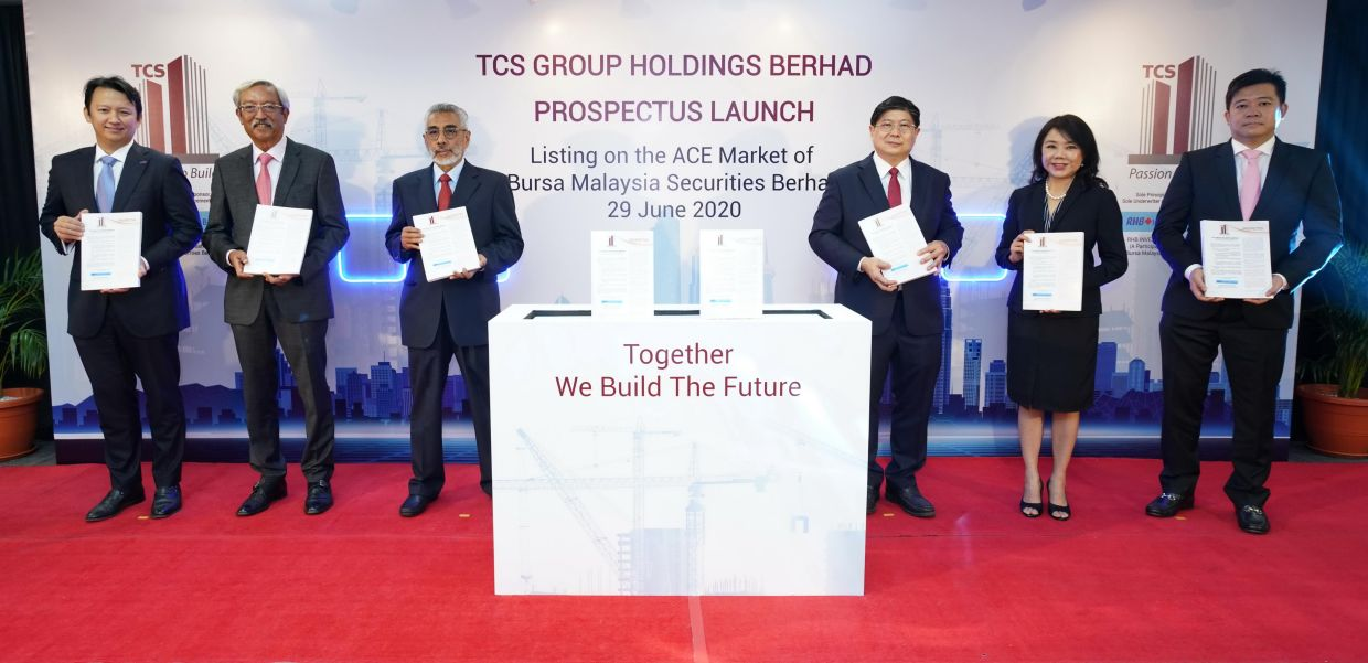From left are Robert Huray, CEO of RHB Investment Bank Bhd and TCS Group officials -- independent director Datuk Seri Mohamad Othman Zainal Azim, chairman Tan Sri Izzuddin Dali, managing director Datuk Tee Chai Seng executive director Datin Koh Ah Nee and independent director Ooi Guan Hoe.