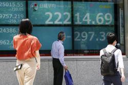 Asian shares slide, following Wall St selloff on virus fears
