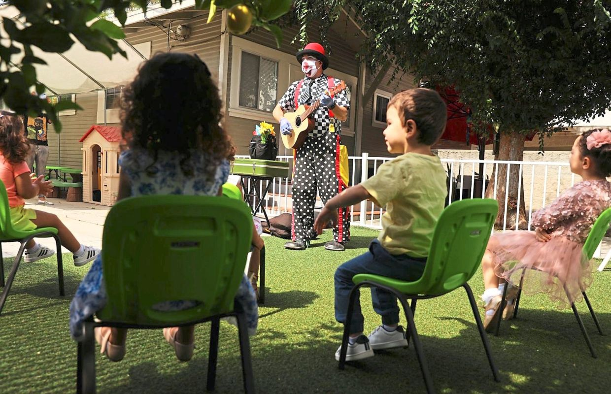 Guilford Adams performing a show at a preschool in Glendale, California, earlier this month. This day-care gig got off to a rocky start as he was unable to rely on the physical stunts that clowns normally rely on. The clowning profession has been changed by the Covid-19 pandemic, he says. — TNS
