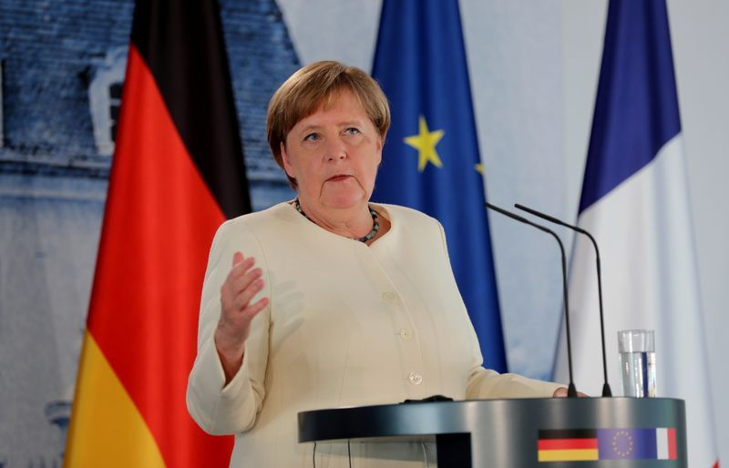 FILE PHOTO German Chancellor Angela Merkel speaks during a joint press conference with French President Emmanuel Macron not pictured after a bilateral meeting at Meseberg Castle the federal governments guest house in Meseberg Germany June 29 2020. Hayoung JeonPool via REUTERSFile Photo