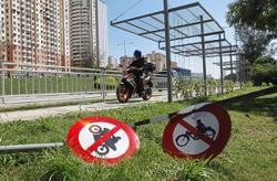 Signboards damaged and danger looms as motorcyclists encroach into bicycle lane