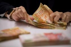 Mainland China allows cross-border wealth flows with Hong Kong, Macao