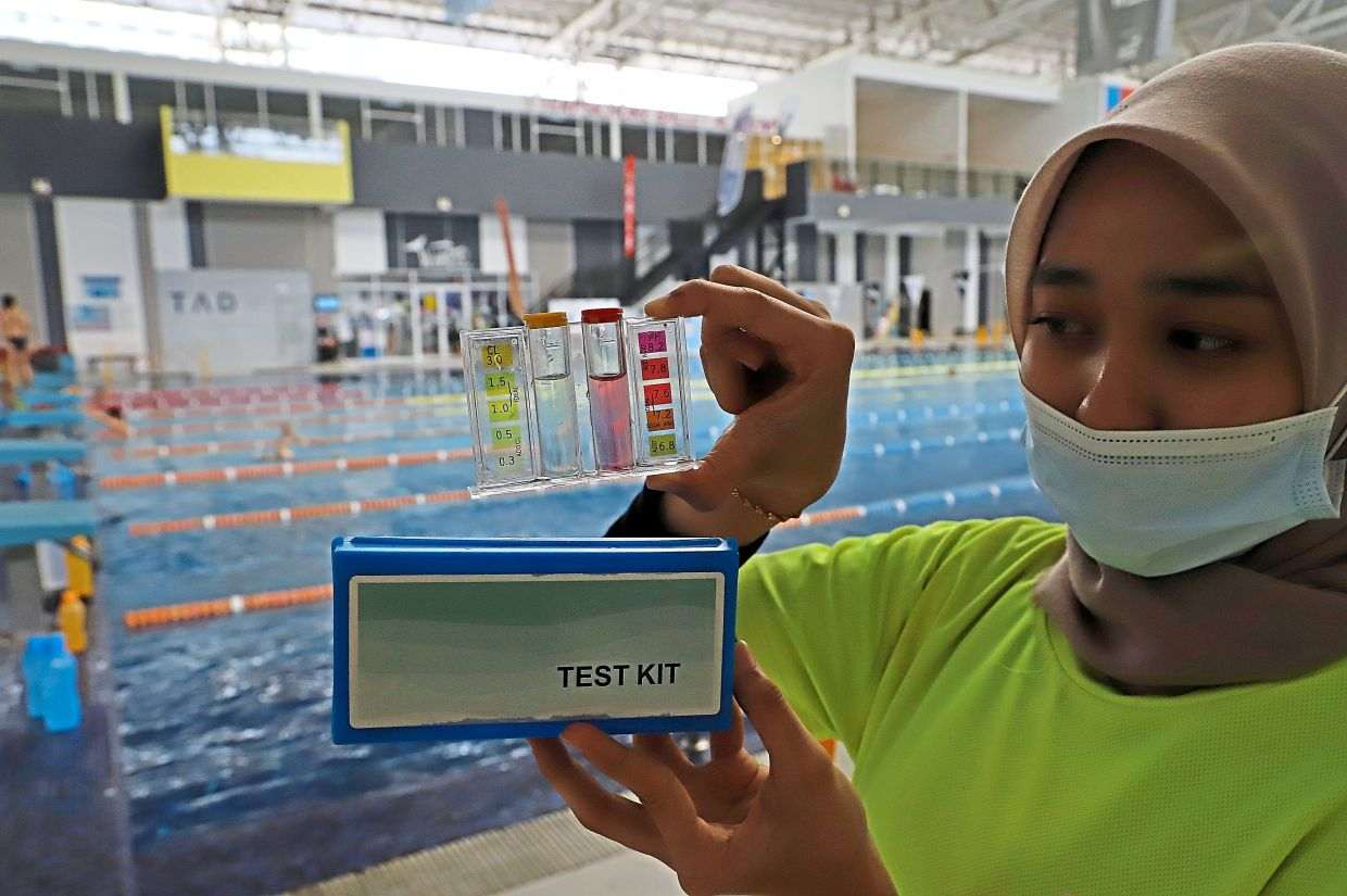 Nur Tasha Affilia Mohd Arif, 20, showing a test kit to check the water quality  at the Setia SPICE Aquatic Centre.