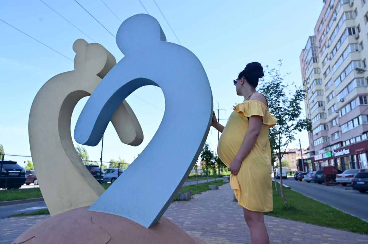 Ukrainian Olga is going through her second surrogacy and expecting twins for a Chinese couple, at Sophiya Borshchagivka, a small town near Kiev. Photo: AFP/Sergei Supinsky