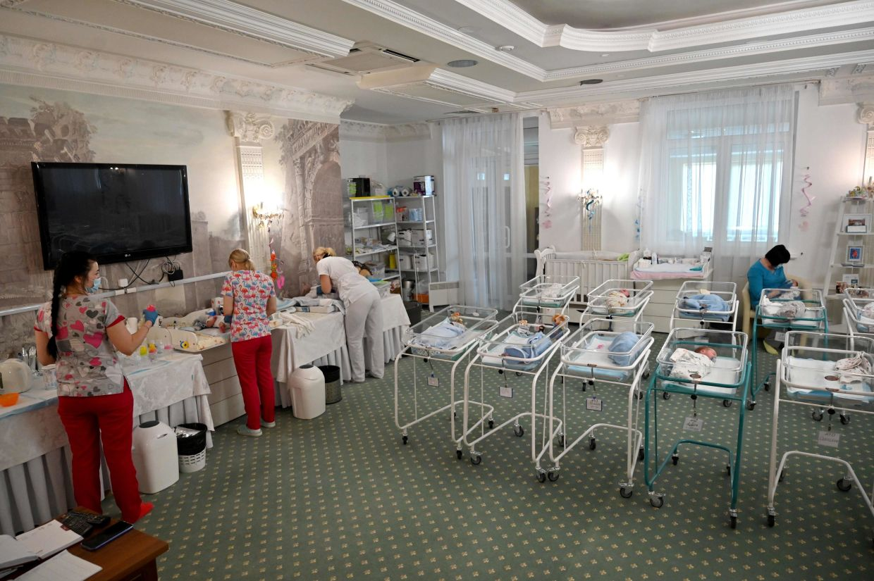Nurses care for the newborn babies at The Hotel Venice in Kiev. Photo: AFP/Sergei Supinsky