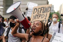 New York City passes budget with police cuts, but some say it's not enough
