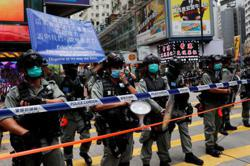 Hong Kong police fire water cannon, arrest 30, as thousands protest against new security law
