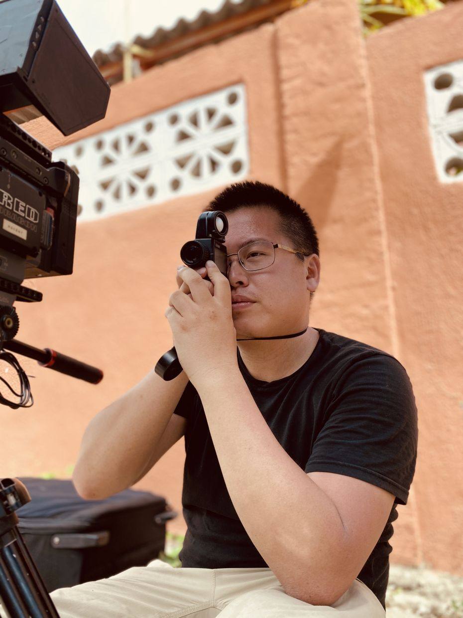 Cinematographer Ong Rui Jiang takes an exposure reading for a sunny scene. Photo: Mario Michael Gonsalves