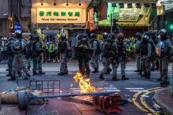 Hong Kong police arrest 370 people, 10 under new security law, as anger boils over in July 1 protests