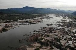 Laos to move on third Mekong dam project despite neighbours' green concerns