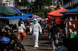 Indonesia seeking its own COVID-19 vaccine amid worry about access