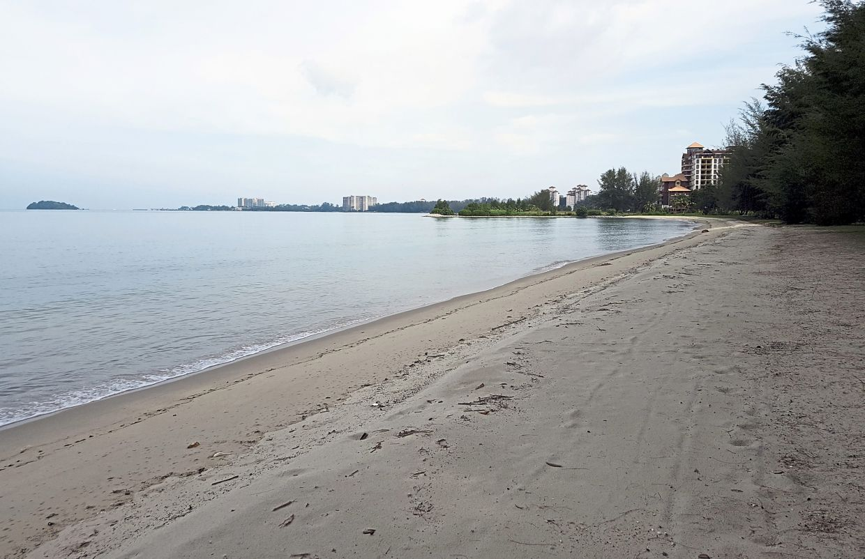 A section of the deserted Telok Kemang beach during the MCO in May and the scene at the beach last weekend (below).