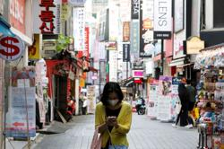 South Korean city returns to tighter social distancing as coronavirus cases spike