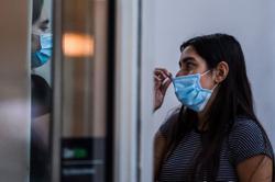 Facebook to advise use of masks amid latest virus spike