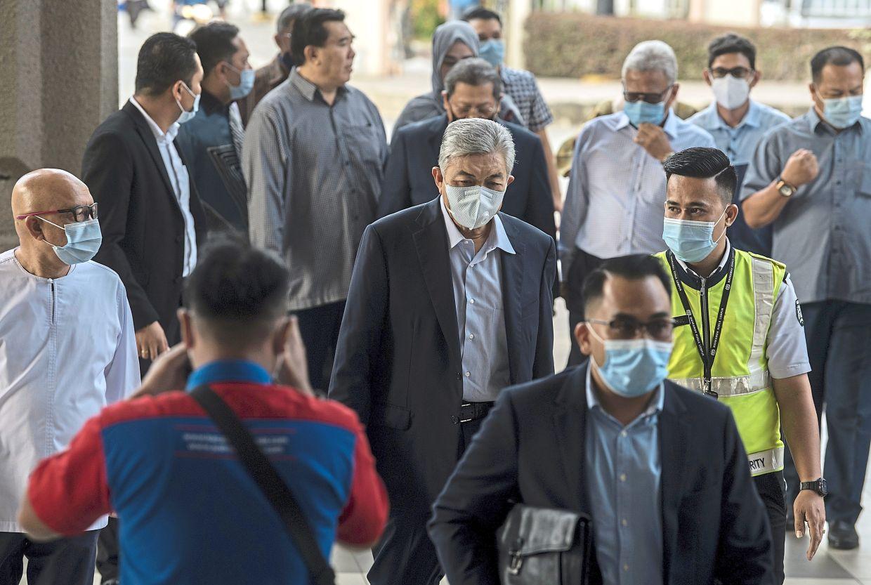 Court date: Ahmad Zahid (centre) arriving at the Kuala Lumpur High Court. — Bernama