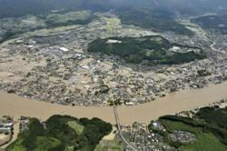 Heavy rain floods southern Japan; over a dozen presumed dead (update)