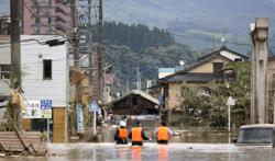 Japan floods: 14 feared dead in nursing home as heavy rain lashes country