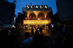 Fans gather for final showings at Thailand's much-loved La Scala theatre