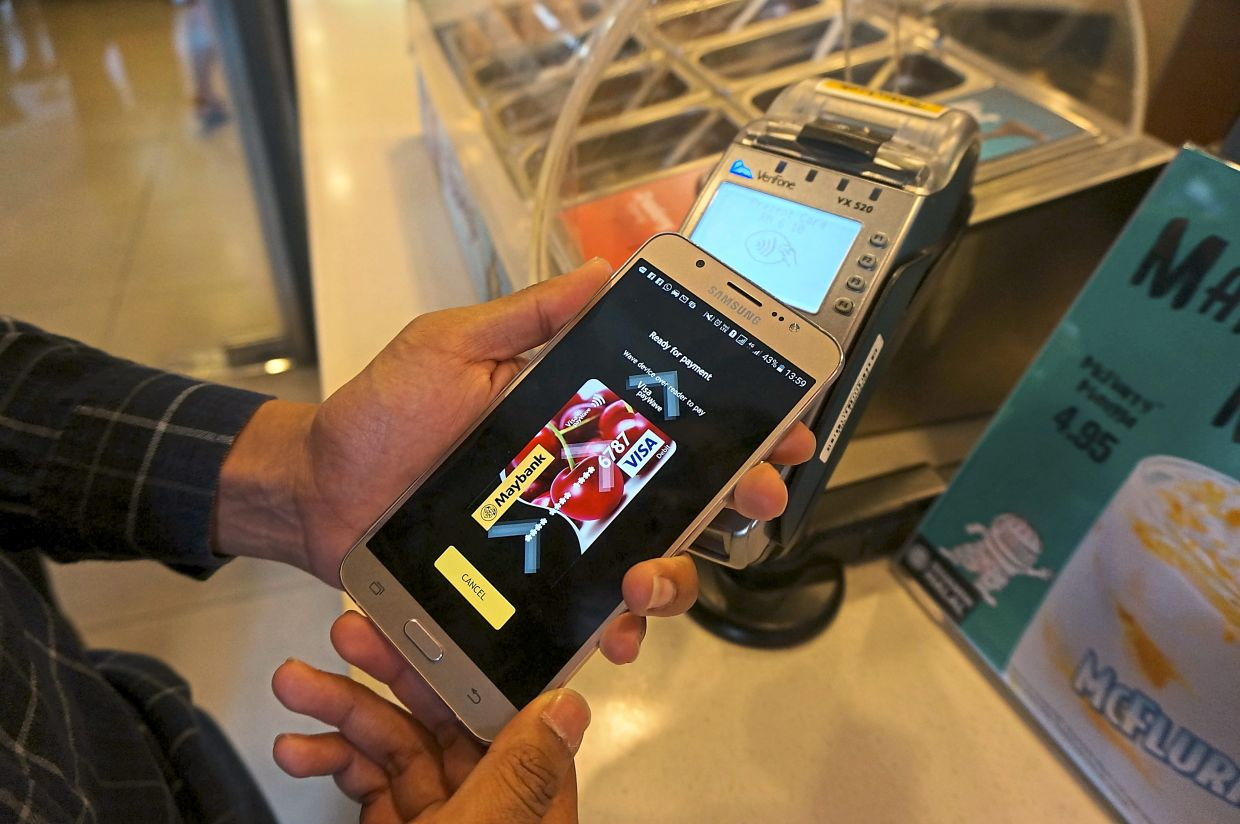 The MaybankPay app, launched in 2016, allowed customers to pay at contactless payment terminals using their smartphones. — JOY LEE/The Star