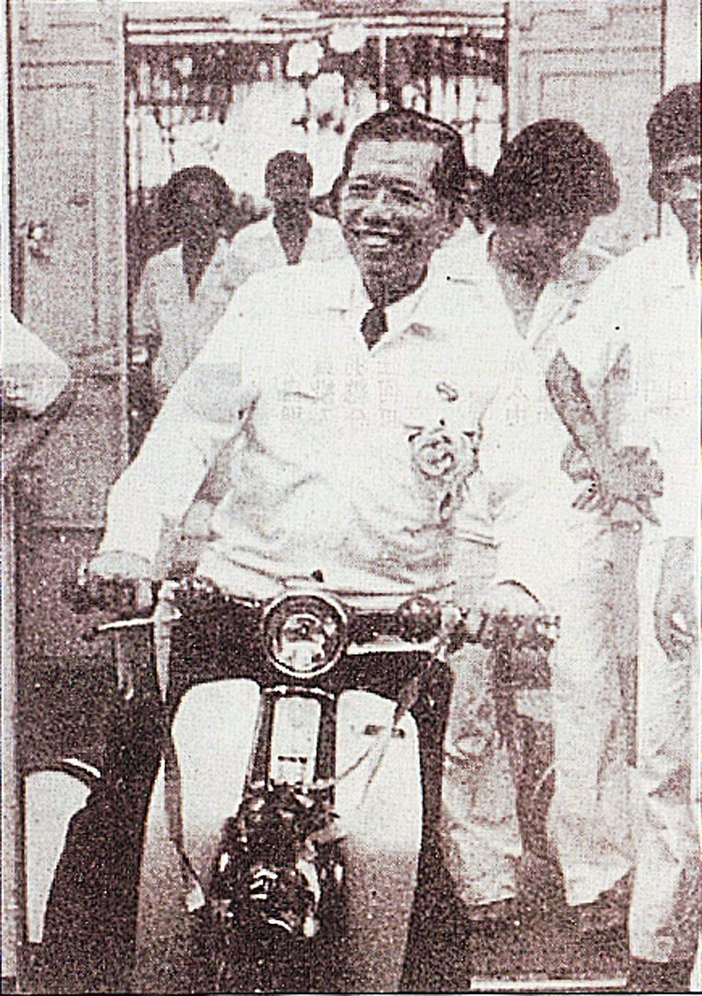 Loh on one of the motorbikes with which he is forever associated. The penniless arrival became an entrepreneur who contributed greatly to society. — Filepic/The Star