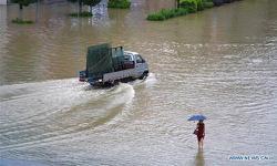 China upgrades emergency response to floods