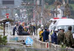 Japan floods leave up to 34 dead, many at nursing homes