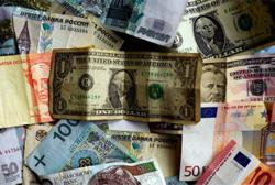 Dollar in tight range ahead of US services sector data