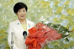 Tokyo governor Koike cruises to second term