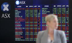 Australia shares end lower as virus spike forces stringent curbs