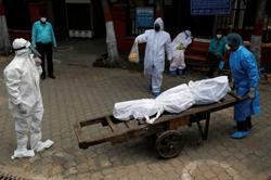 India's coronavirus death toll hits 20,000 as infections surge