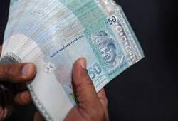 Emerging markets: Malaysia's ringgit falls off two-week high after rate cut