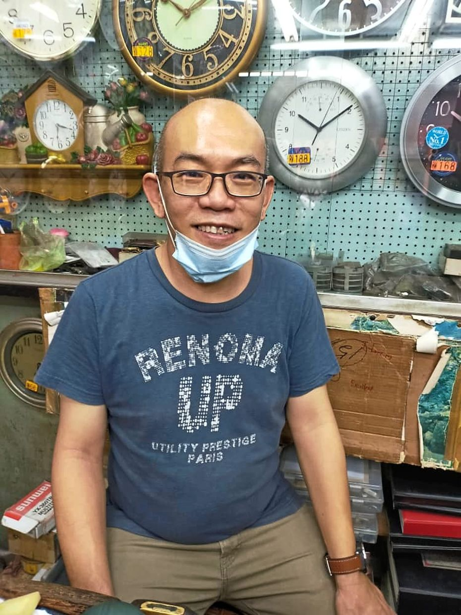 Wong says business at his shop selling and repairing watches and clocks is slowly picking up.