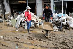 Masks, disinfectant, social distancing: Japan responds to disaster amid coronavirus